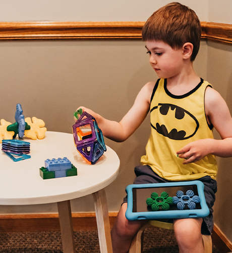 Child playing with toys in waiting area