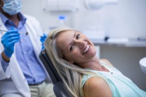 Woman who is relaxed smiling in dental chair